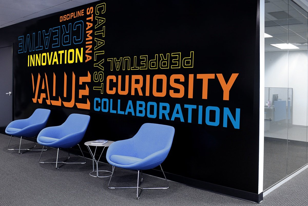 This company's pop of colorful branding makes this office's look.