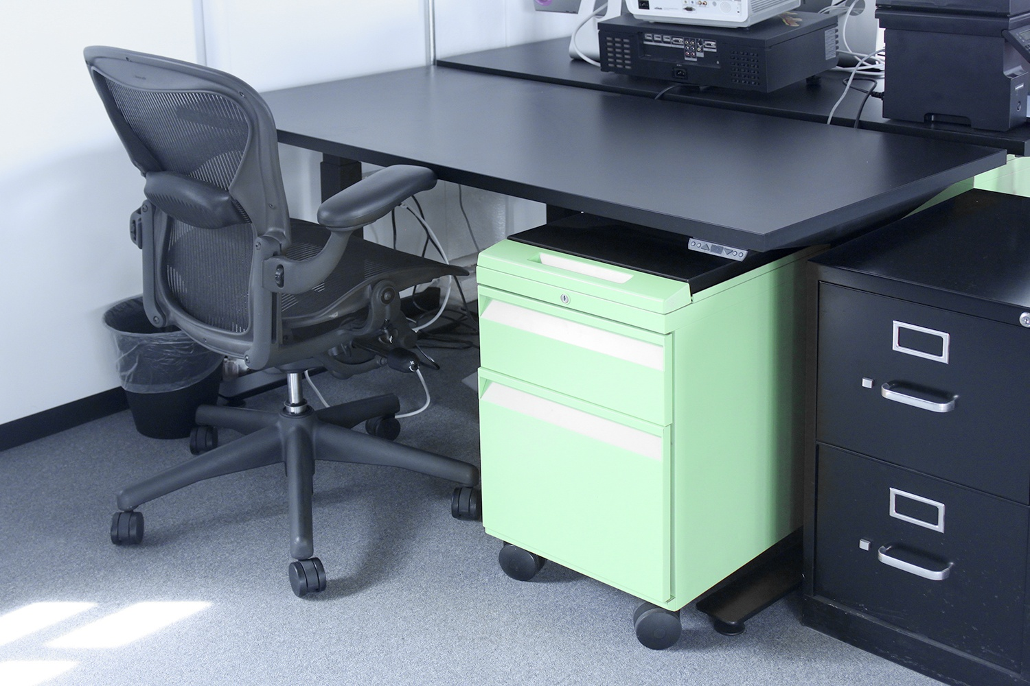Sit-stand desks with Herman Miller Aeron task chairs.
