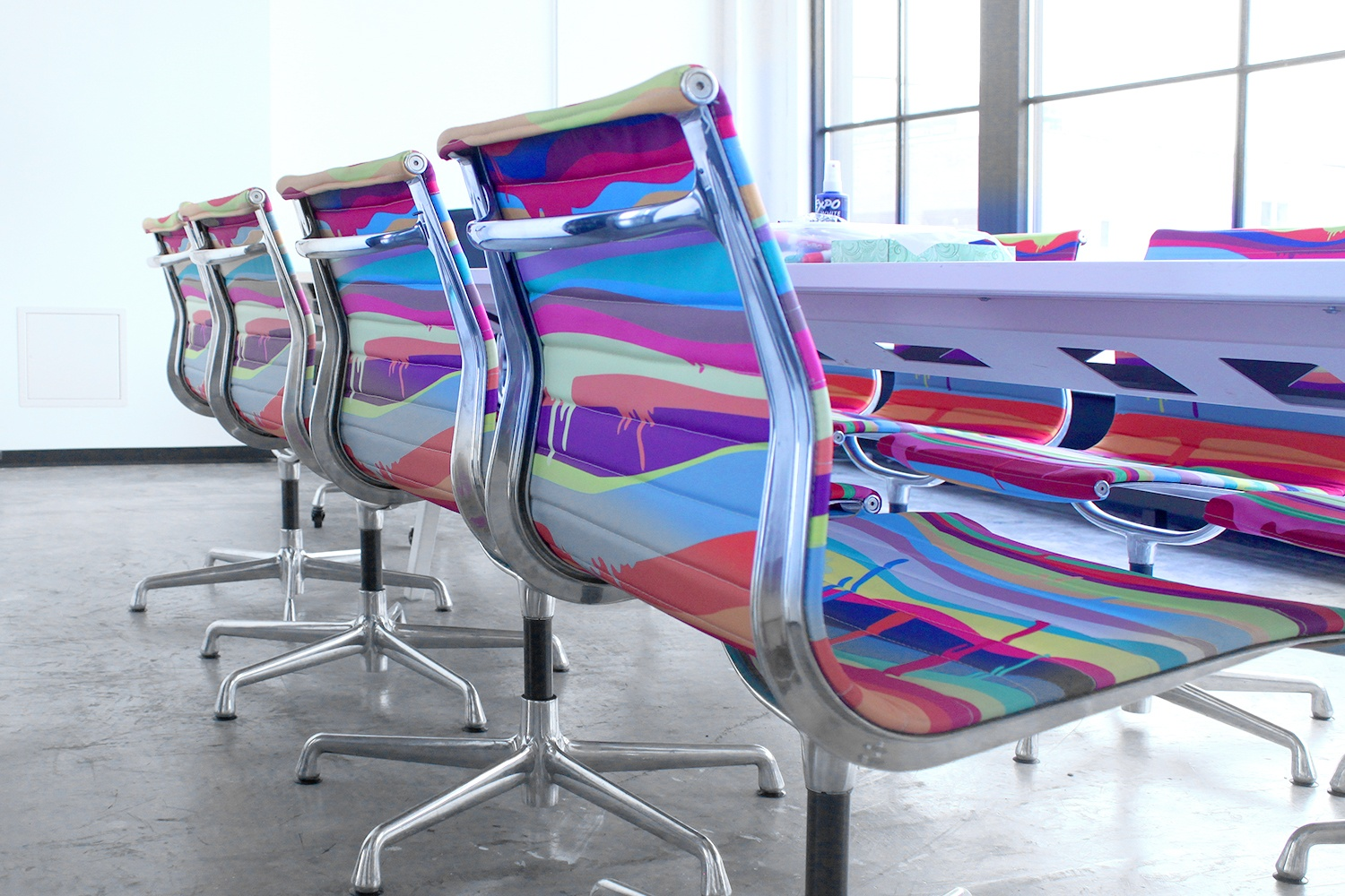 Herman Miller conference chairs in Threadless's custom upholstery.